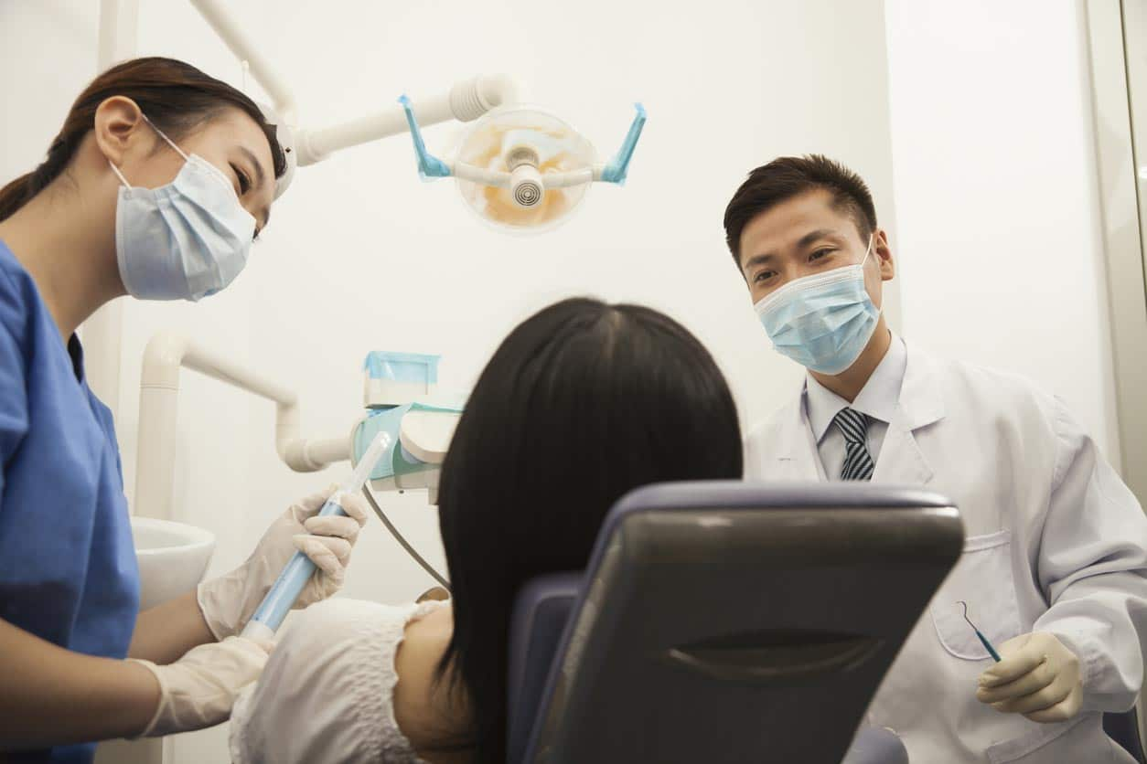 Dentists Examining Female Patient