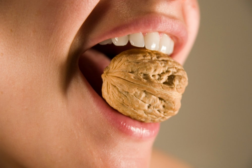 Picture of a lady chewing nuts
