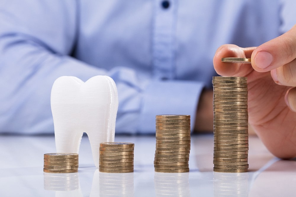 Picture of a dummy tooth with coins