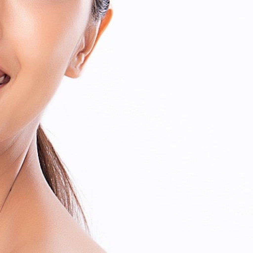 Picture of a lady smiling showing her bright teeth