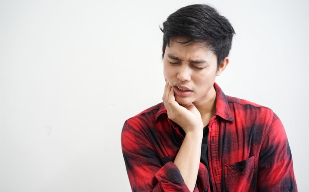 Picture of a guy suffering from tooth pain